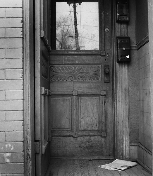Minor White doorways haunt my image stalking. I see tones, reflections and, stories told in unread newspapers on the doorstep.