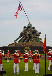 "The Sunset Parade features the music of ""The Commandant's Own"", The United States Marine Drum and Bugle Corps and precision drill by the Marine Corps Silent Drill Platoon (on August 7, 2012)"