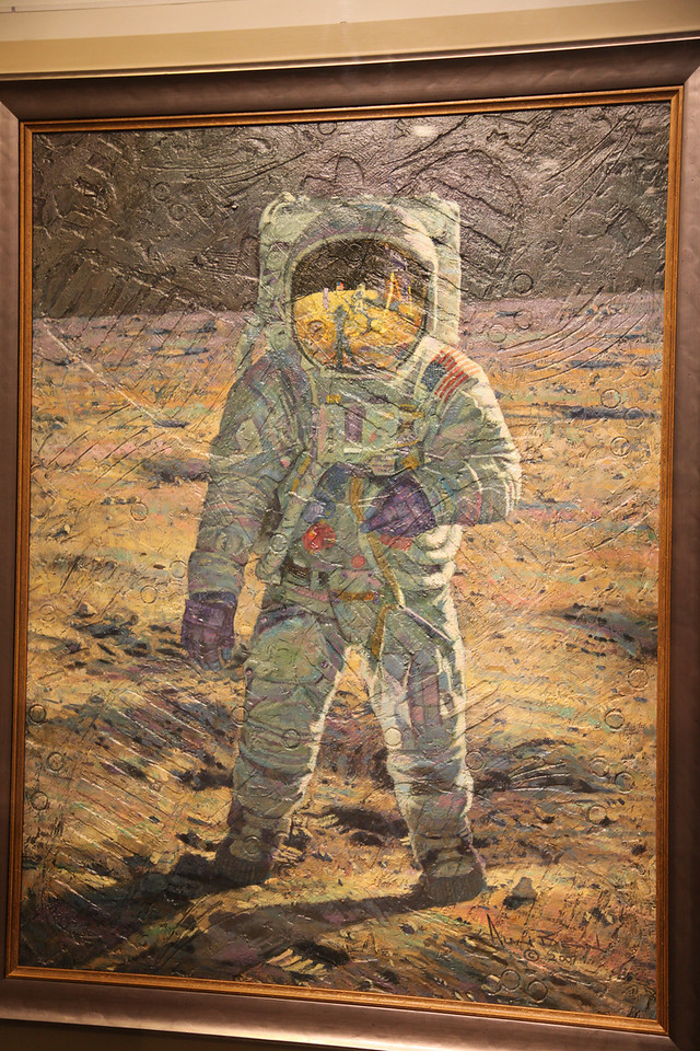 Painting of Apollo 11 astronaut Buzz Aldrin on the moon.  Painted by Apollo 12 astronaut, Alan Bean.  Note the impressions of the moon boot sole, a round coring bit, and the arcs made by the side of his prospecting hammer.