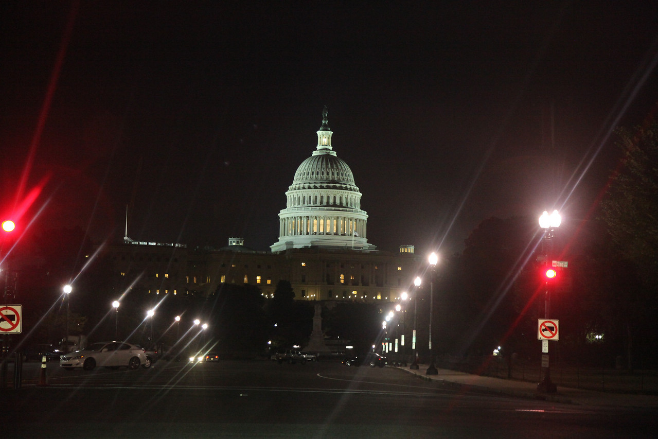 Front of US Capitol Building taken through the windshield of an automobile.