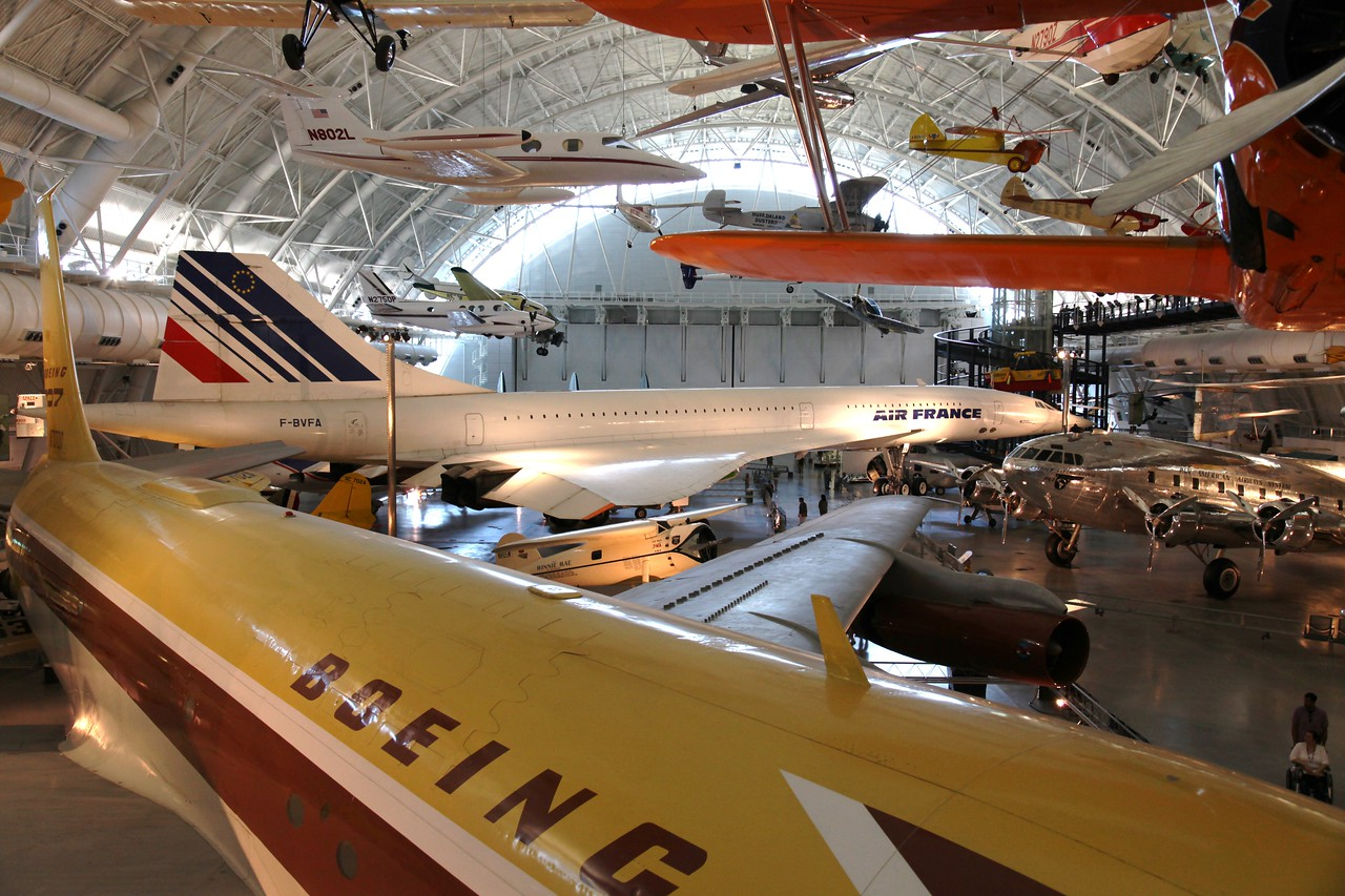Boing 707 in front of an Air France Concorde -- National Air & Space Museum Annex, Dullex Airport, VA.  The small plane between is the Winnie Mae, Wiley Post's plane in which he flew around the world.