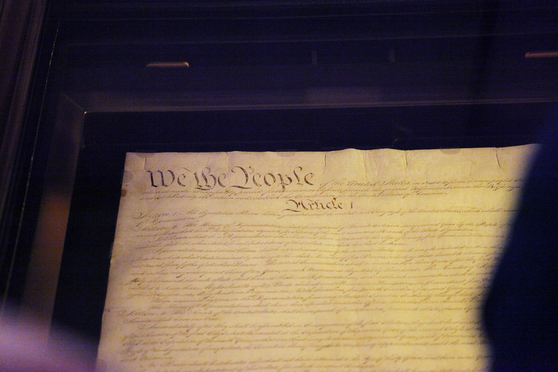 Page One of the original US Constitution -- National Archives.  Due to potential damage to the documents, no flash photography is allowed.