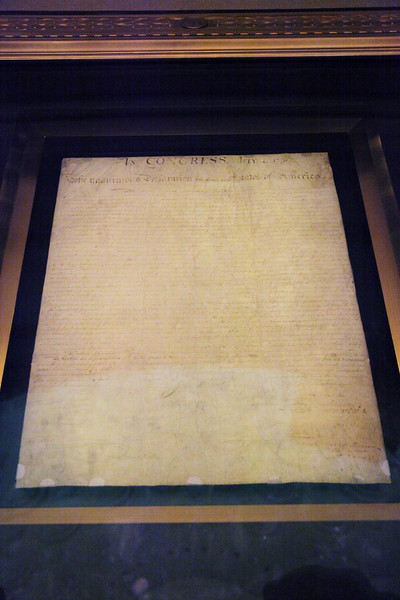 The Original Declaration of Independence -- National Archives.  No flash photography is allowed.  This document is almost unreadable due to exposure to sunlight which occurred before it was known that light causes the ink to fade.