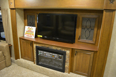 With a fire place and big screen TV.