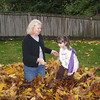 Playing in the leaves with grandma