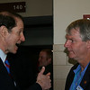 Oregon Sen. Ron Wyden talks to a delegate at the Democratic National Convention in Denver, Wednesday, August 27, 2008. (Anne-Marie Taylor Lathrop)