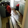 Woodard Restoration takes up the laminate flooring.  Water was under most of it.  10-24-11