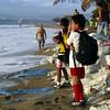 2001/02.  Waves encroach on El Burro restaurant as the school kids look on.