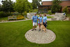 Wayzata,  -  Wayzata Gardens - City of Wayzata Gardens ***GARDEN #12 ***Robert Peterson, Lindsey Peterson and Tina Montgue of the Waycliffe Book Club at the Wayzat aLibrary Garden (North) (not pictured- Judith Fransler, Mary Pagnucco, Greta Pofcher, Betty McGrory and Pat Grossman). Date: Saturday July 31, 2010 Photo by © Todd Buchanan 2010 Technical Questions: tbuchanan@greenspring.com; Phone: 612-226-5154. Keywords: flowers, gardens, suburban, city gardens, summer,