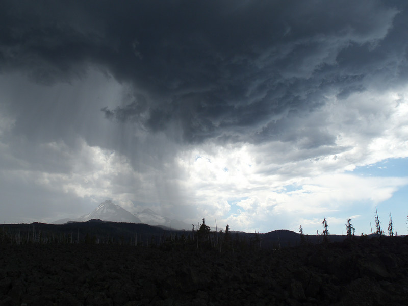 Rain is just beginning to fall on this side of North & Middle Sisters.