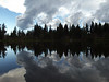 Active clouds reflected in South Matthieu Lake.