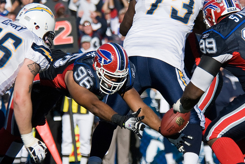 Buffalo Bills' Copeland Bryan recovering a San Diego Cargers' fumble in the second half of the NFL football game at Ralph Wilson Stadium in Orchard Park, N.Y., Sunday, Oct. 19, 2008.