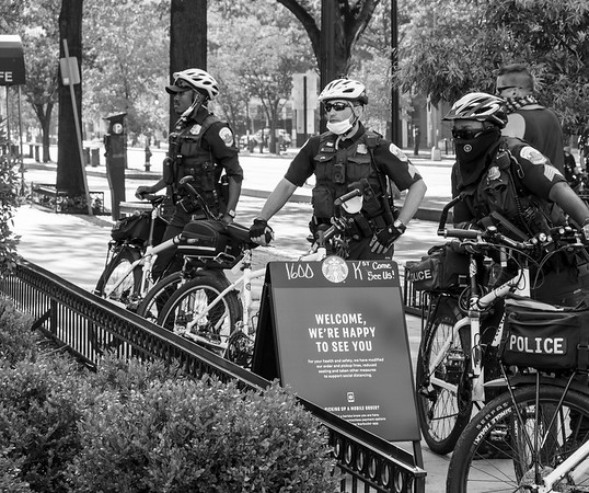 July 4, 2020, Washington, DC- Metro police officers keep an eye on protesters near the White House.