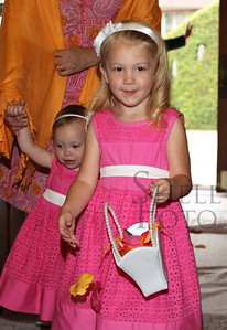Beautiful flower girls, all dressed in pink.