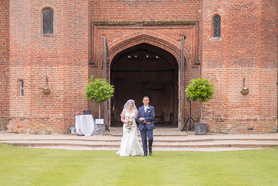 Its all about the bride at leezy priory | Hannah walking with Dad to meet her guests unter the tower for an outside ceremony