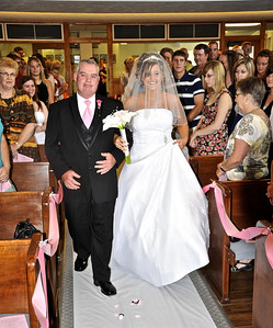 I was NOT the Official Wedding photographer for this wedding. I shot these from my seat in the pew. This is my nephews wedding I attended in Iowa. I was injured at the time and could not commit to taking the entire wedding for them, which was sad for me