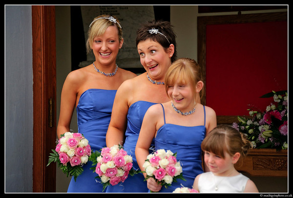 The bridesmaids take a brief moment of relaxation at the wedding of Chris & Karen Johnston