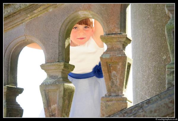 A bridesmaid peeks through the ballastrade at Belfast Castle
