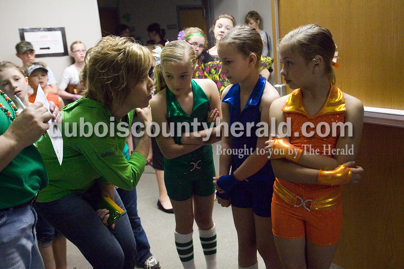 Jeana Harpenou of Jasper gave last minute direction to, from right, her daughter Halee, Emily Heim of Ireland, 9, and Charlotte Jaqua of Jasper, 10, during the Ireland's Got Talent contest at Ireland Elementary School Sunday afternoon. Brooke Stevens/The Herald
