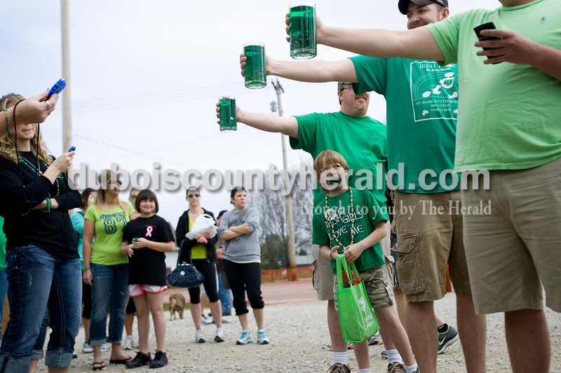Wyatt Leinenbach of Hartsburg, 7, watched as his father uncles competed in the Toast to the O' Blarney Drop Saturday morning during the St. Patricks Celebration in Ireland. The competition is new this year and requires participants to hold a scooner filled with water as long as possible while keeping their arm straight. Brooke Stevens/The Herald