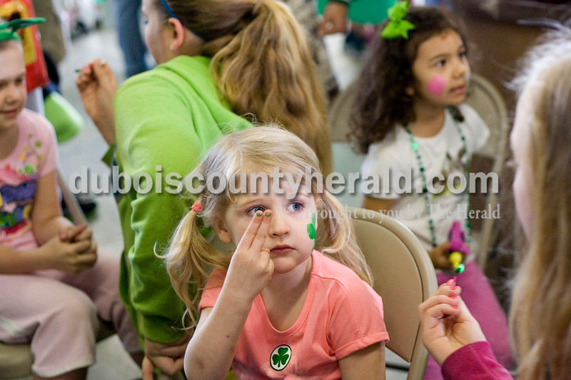 Jasmine Netherland of Washington, 4, motioned that she wanted both sides of her face painted to Averie Himsel of Ireland, 12, Saturday morning at the Ireland Fire Department. Brooke Stevens/The Herald