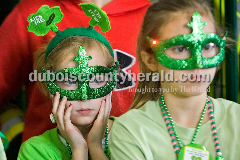 Kennedy Miller, left, of Noblesville, 8, and Megan Hemmings of Indianapolis, 11, hung out at the Ireland Fire Department where kids activities were held Saturday morning during the St. Patrick's Celebration in Ireland. Brooke Stevens/ The Herald