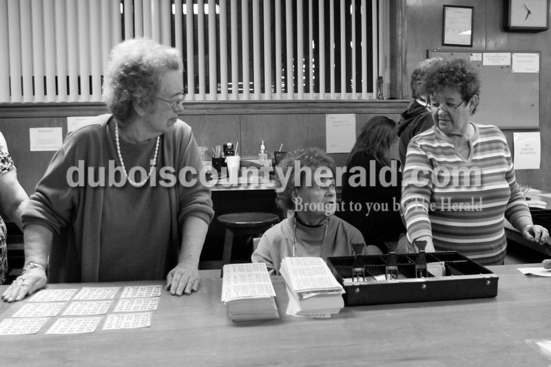 Sisters, from left, Louise Schitter, Sally Rees and Annie Messier, all of Jasper, sell Bingo cards January 18 at the American Legion in Jasper. Brooke Stevens/The Herald