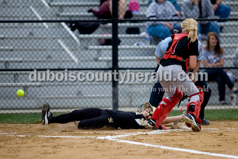 Jasper's Lindsay Baker slid into home base during Thursday nights game against North Knox. The Wildcats defeated the North Knox Warriors 18-5. Brooke Stevens/The Herald