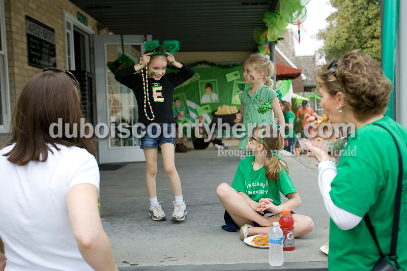Addy Oswalt, left, of Gahanna, Ohio watched as her daughter Ella, 5, played with her shamrock headband as Brooke Williams, 4, and her sister Brianna, 7, watched with their mother Renee, right, of Ireland, during the St. Patricks Day Celebration in Ireland Saturday afternoon. Brooke Stevens/The Herald