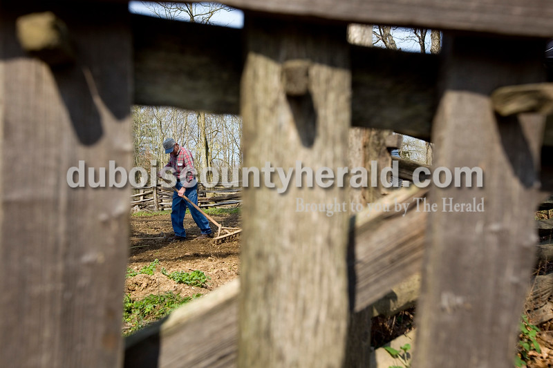 Dave Weatherwax/The Herald<br /> Richard Betz of Dale used an old, wooden rake to help prepare the ground to plant lettuce in the garden at the living historical farm at the Lincoln Boyhood National Memorial in Lincoln City on Saturday morning.