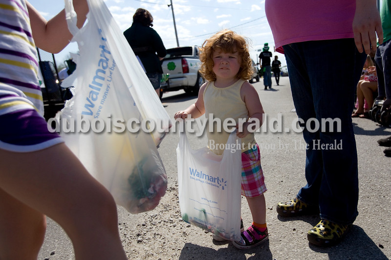 Matelyn Russell of Huntingburg, 2, waited for more candy during the St Patricks Celebration Parade in Ireland Sunday afternoon. Brooke Stevens/The Herald
