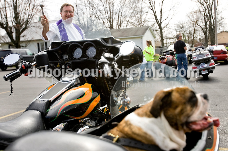 Father Ron Kreilein of St. Mary's church in Ireland blessed the bike of Tom Rasche of Dubois while his English Bulldog, Angus, sat in the side car. Brooke Stevens/ The Herald