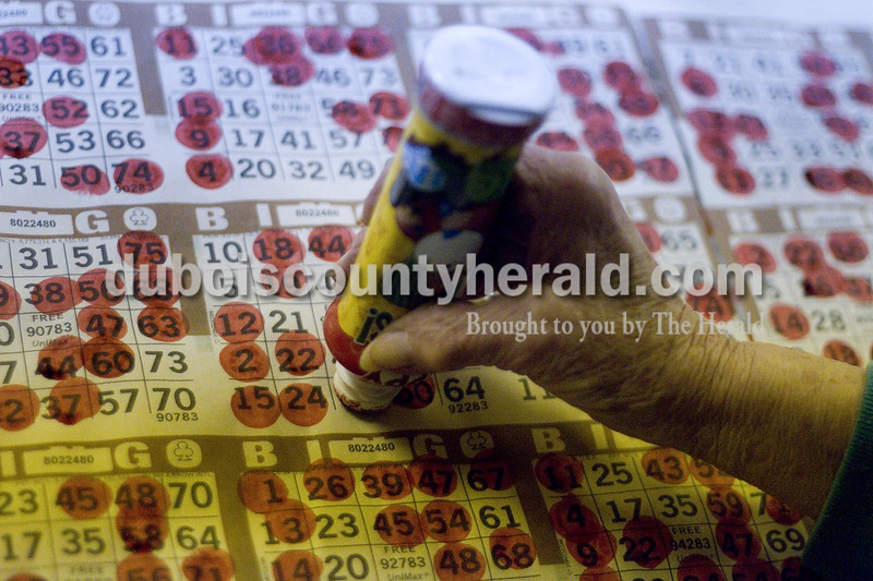 """Sally Rees marked her Bingo card during a """"cover all"""" game at the American Legion in Jasper on March 14. The """"cover all"""" is one of over 20 games participants play each Wednesday where ever number on a card has to be called to win. Brooke Stevens/The Herald"""