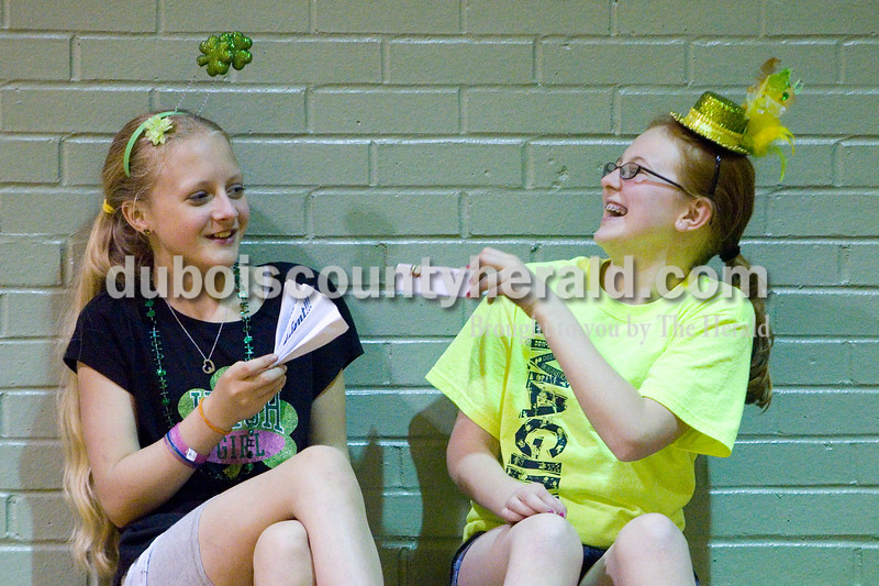 Anna Jones of Ireland, 12, and Ashley Whitsitt of Jasper, 12, laughed in the stands at Ireland Elementary School during the Ireland's Got Talent contest Sunday afternoon. Brooke Stevens/The Herald