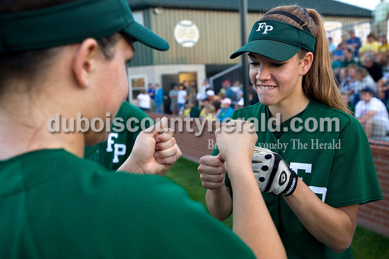 Forest Park's Shelby Bettag, left, and Allison Hoffman exchanged fist bumps before the start of Tuesday night's Class 2A softball sectional against South Spencer in Bretzville. The Rangers won 13-3 in five innings. Dave Weatherwax/The Herald