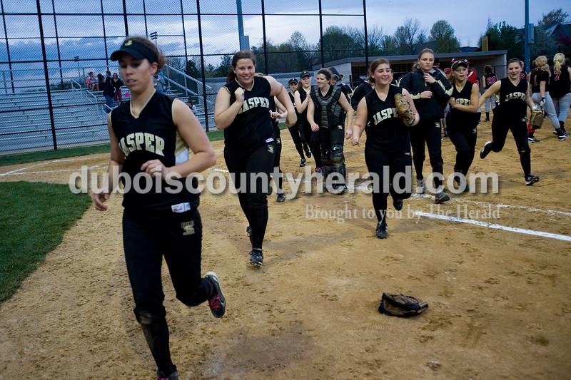 Jasper's varsity softball team runs off the field after Thursday nights game against North Knox. The Wildcats defeated the North Knox Warriors 18-5. Brooke Stevens/The Herald