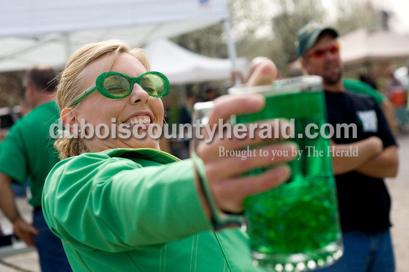 Gina Beyke of Jasper competed in the Toast to the O' Blarney Drop Saturday morning during the St. Patricks Celebration in Ireland. The competition is new this year and requires participants to hold a scooner filled with water as long as possible while keeping their arm straight. Brooke Stevens/The Herald
