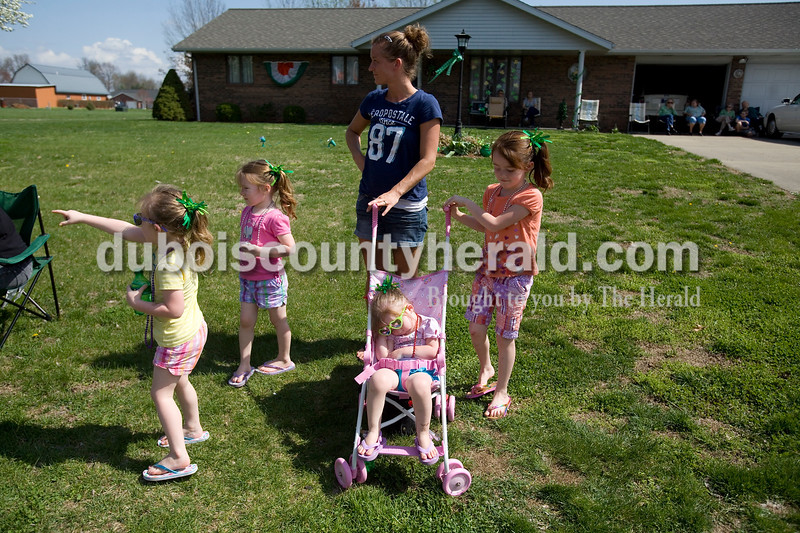 The Fultz family, from left, Candence and Kaylee, both four, Crystal, Hope, 7, and Emma, 2, (sitting) of Jasper watched the St. Patricks Celebration Parade in Ireland Sunday afternoon. Brooke Stevens/The Herald