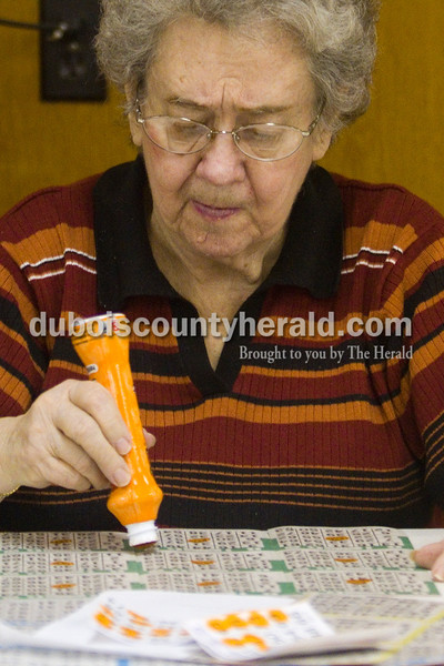 Louise Schitter of Jasper marked her card during Wednesday night Bingo at the American Legion on February 29. Brooke Stevens/The Herald