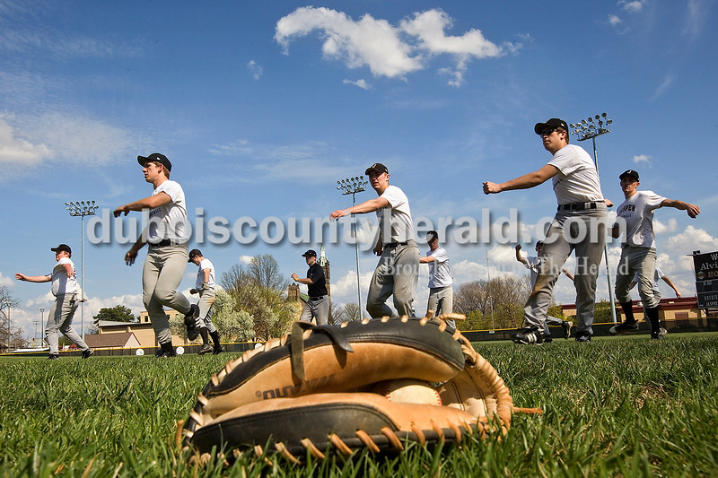 Dave Weatherwax/The Herald<br /> Members of the Jasper baseball team stretched before practice Monday afternoon at Ruxer Field in Jasper.