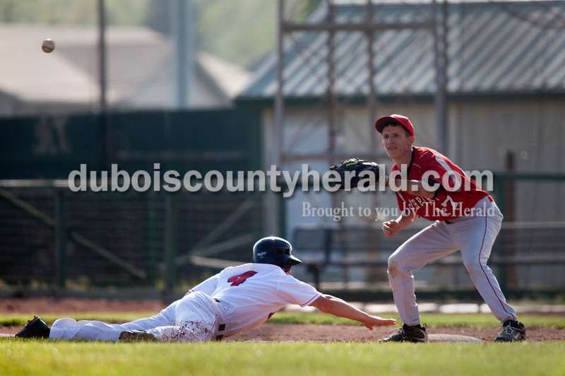 Brooke Stevens/The Herald<br /> Southridge's Ben Weber reached for first base with Southport's Brian Boucher making the catch during Saturday afternoons game in Huntingburg.