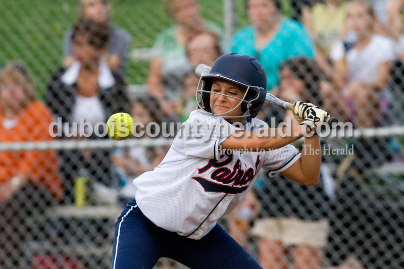 Brooke Stevens/The Herald<br /> Heritage Hills' Toni Braun watched the ball while at bat during Tuesday nights game against Jasper at Lincoln City. Heritage Hills defeated Jasper 5-4.