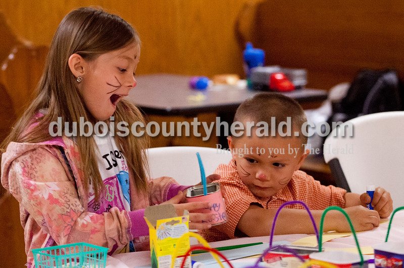 Brooke Stevens/The Herald<br /> Natilee Wahl of Huntingburg, 7, showed off her finished miniature easter basket with her brother Bryan, 4, Saturday morning during the Breakfast with the Easter Bunny fundraiser for Hummingbird Daycare at Teen Outback in Huntingburg. More then 85 children came to visit with the Easter Bunny, play games, and make crafts during the event.