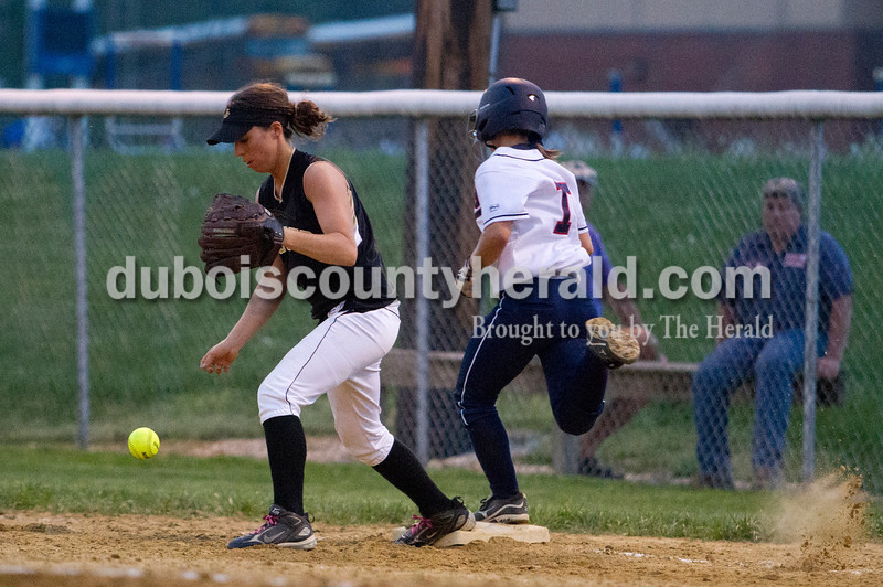 Jasper's Taylor Main dropped the ball as Heritage Hills' Toni Braun ran to first base during Tuesday nights game against at Lincoln City. Heritage Hills defeated Jasper 5-4.