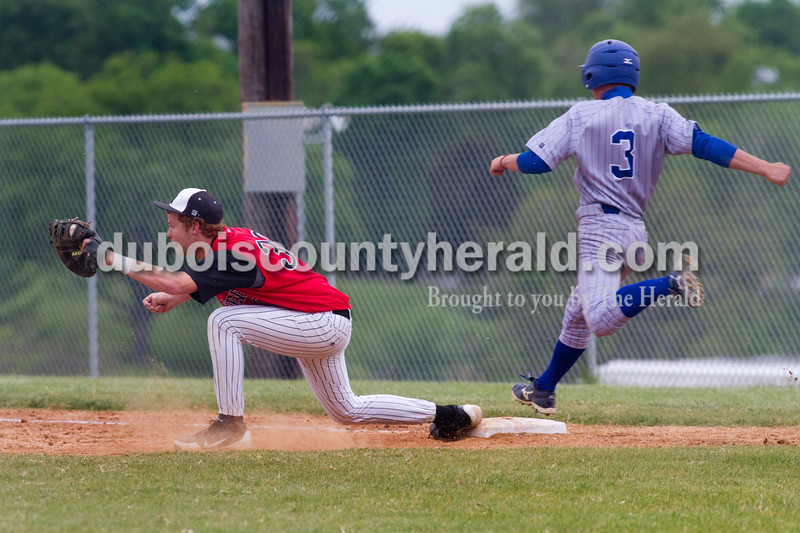 Brooke Stevens/The Herald <br /> Northeast Dubois' Shane Troutt ran to first base as Barr Reeve's Heath Graber covered the plate during Tuesday nights game at Dubois.