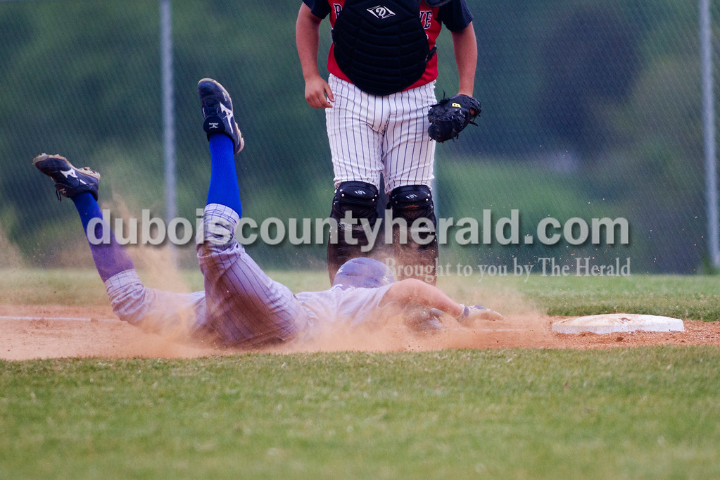 Brooke Steves/The Herald<br /> Northeast Dubois' Jace Terwiske tried to salvage an attempted steal while Barr Reeve catcher Stanley Kemp waited for the ball during Tuesday nights game at Dubois.