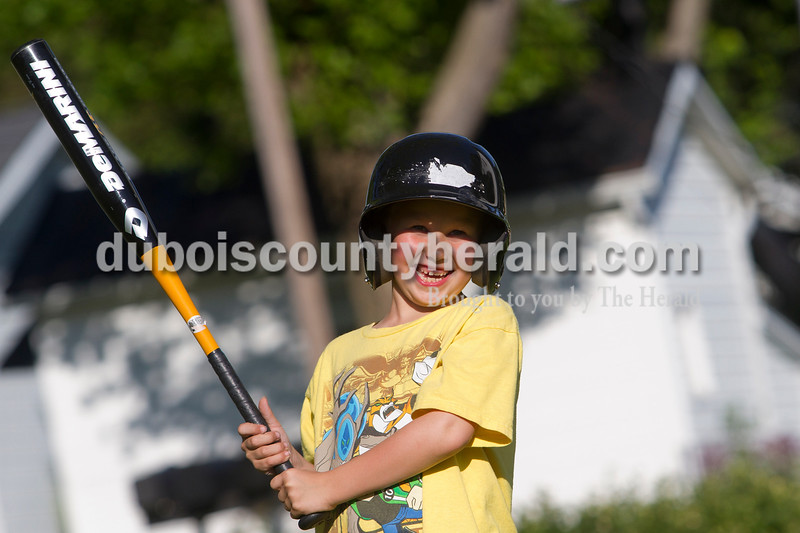 Brooke Stevens/The Herald<br /> Dustin Crecelius of Ferdinand, 8, laughed at his grandfather, Mike Oser, also of Ferdinand, during baseball practice in the backyard of Crecelius' home Wednesday afternoon. Dustin's brothers Alex Crecelius, 9, and Issac Mohr, 4, joined in the game.
