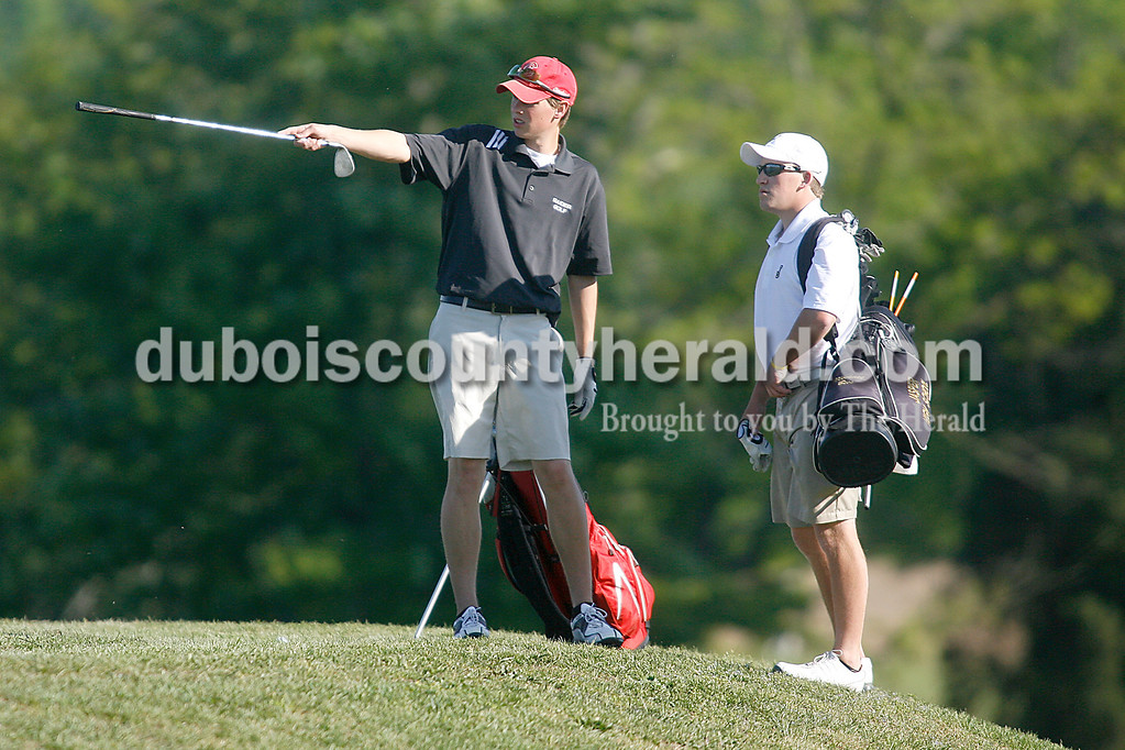 Rachel Mummey/The Herald<br /> Southridge's Ian Matheis points in the direction of the putting green of the hole five as he discusses strategy with Jasper's Michael Bies at Huntingburg Country Club on Wednesday.