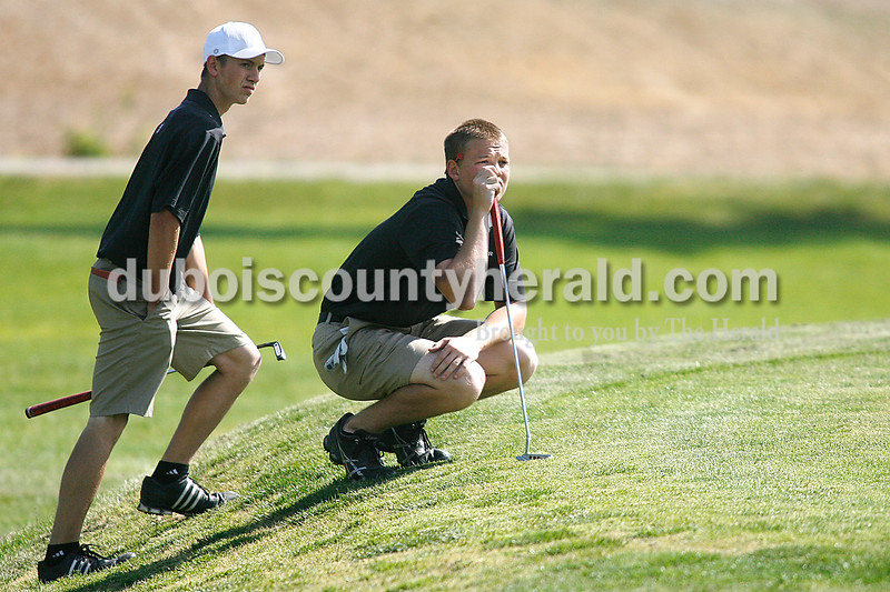 Rachel Mummey/The Herald<br /> Southridge's Tyler Gray and Beau Schneider assessed the situation on the green of hole one during their golf competition against Jasper at Huntingburg Country Club on Wednesday.