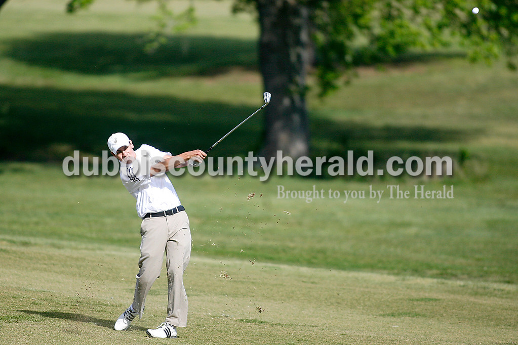 Rachel Mummey/The Herald<br /> Jasper's Will Segers hit the ball down the faraway of hole five during their golf competition against Southridge at Huntingburg Country Club on Wednesday.